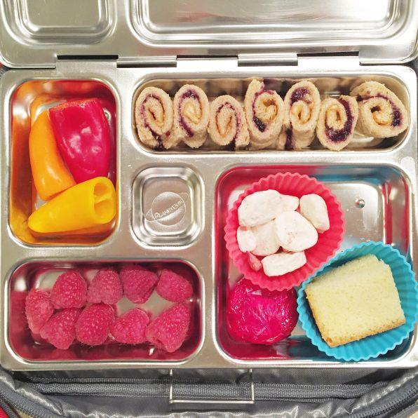 baby peppers, raspberries, freeze-dried bananas, cheese, lemon cake and sunbutter/jam sammie roll-ups