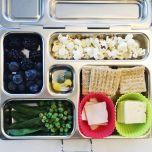 crackers, cheese, turkey, popcorn, bluebs, backberries, sugar snap peas, peas, dye free chocolates