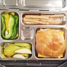 turkey & cheese on a roll, whole wheat pretzels, peppers, pears