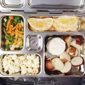 mixed veggies (from frozen organic), orange segments, pretzel bites, cream cheese, popcorn